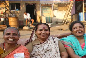 Indian women smiling on a bench